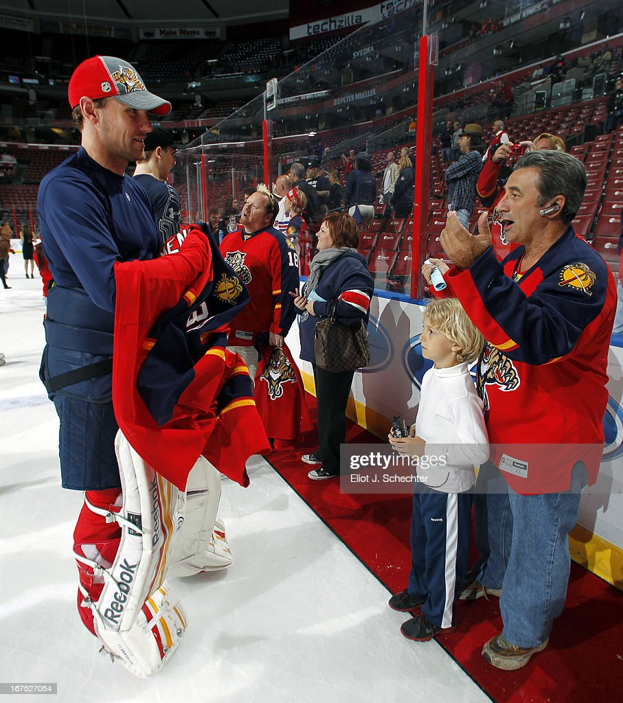 Goaltender Scott Clemmensen of the Florida Panthers hands over his jersey to fans after beating the New York Rangers at the BBT Center on April 23...