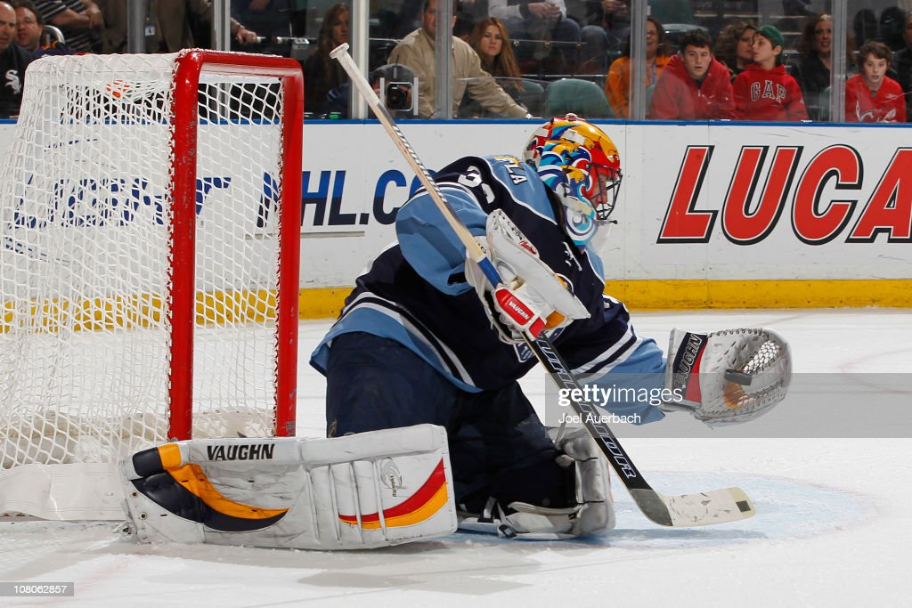 Goaltender Scott Clemmensen of the Florida Panthers makes a glove save against the New Jersey Devils on January 15 2011 at the BankAtlantic Center in...