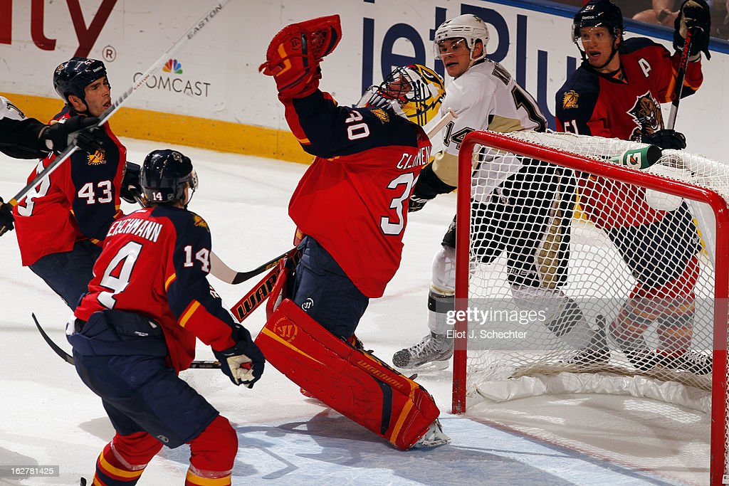 Goaltender Scott Clemmensen #30 of the Florida Panthers makes a glove save against the Pittsburgh Penguins at the BB&T Center on February 26, 2013 in Sunrise, Florida.
