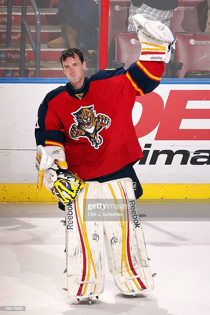 Goaltender Scott Clemmensen of the Florida Panthers salutes the crowd after beating the Ottawa Senators 21 at the BBT Center on April 7 2013 in...