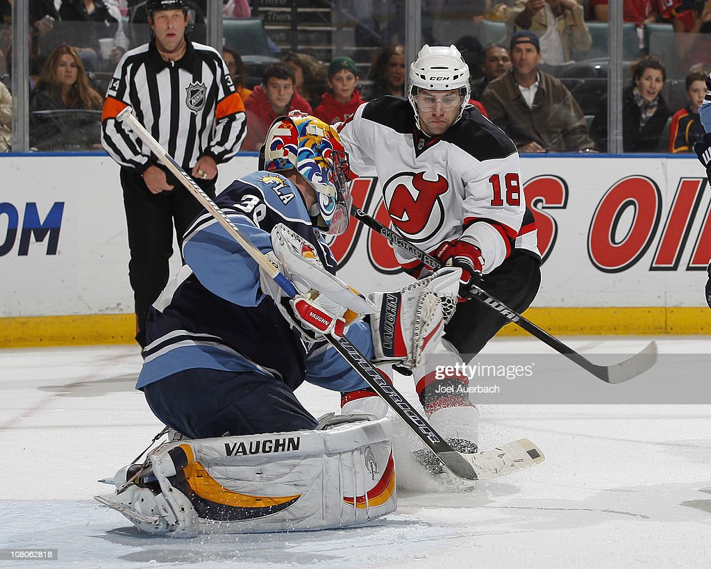 Goaltender Scott Clemmensen of the Florida Panthers stops a shot by Vladimir Zharkov of the New Jersey Devils on January 15 2011 at the BankAtlantic...