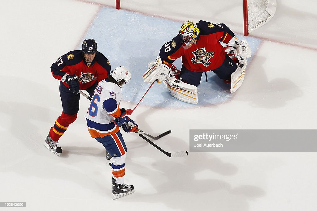 Goaltender Scott Clemmensen #30 of the Florida Panthers stops a shot by Matt Moulson #26 of the New York Islanders at the BB&T Center on March 16, 2013 in Sunrise, Florida. The Islanders defeated the Panthers 4-3.