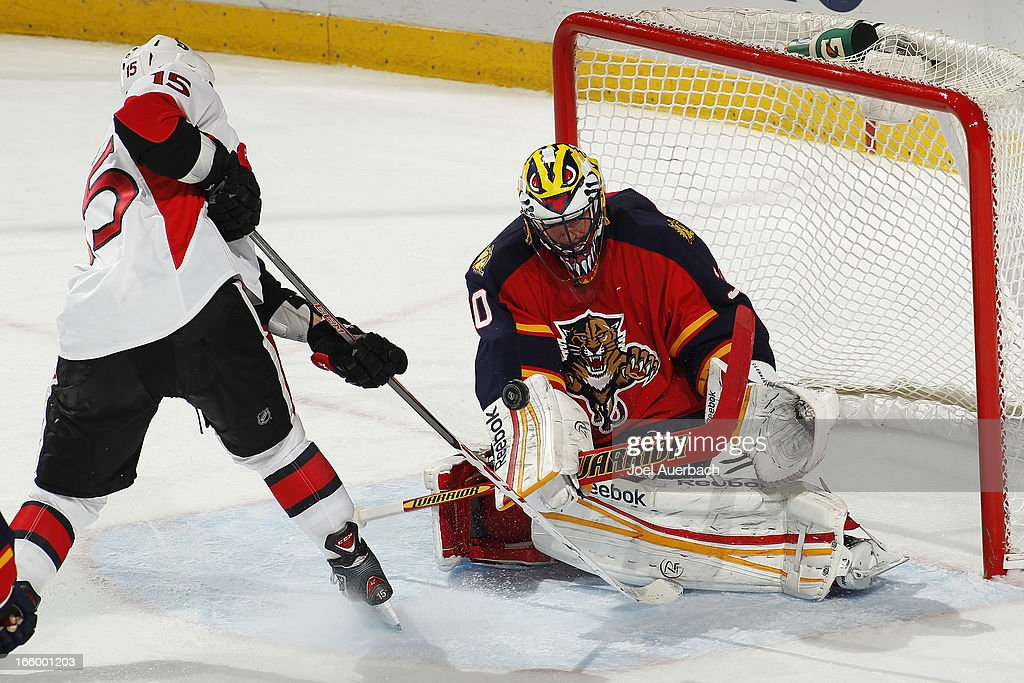 Goaltender <a gi-track='captionPersonalityLinkClicked' href=/galleries/search?phrase=Scott+Clemmensen&family=editorial&specificpeople=214674 ng-click='$event.stopPropagation()'>Scott Clemmensen</a> #30 of the Florida Panthers stops a shot by Zack Smith #15 of the Ottawa Senators at the BB&T Center on April 7, 2013 in Sunrise, Florida. The Panthers defeated the Senators 2-1.