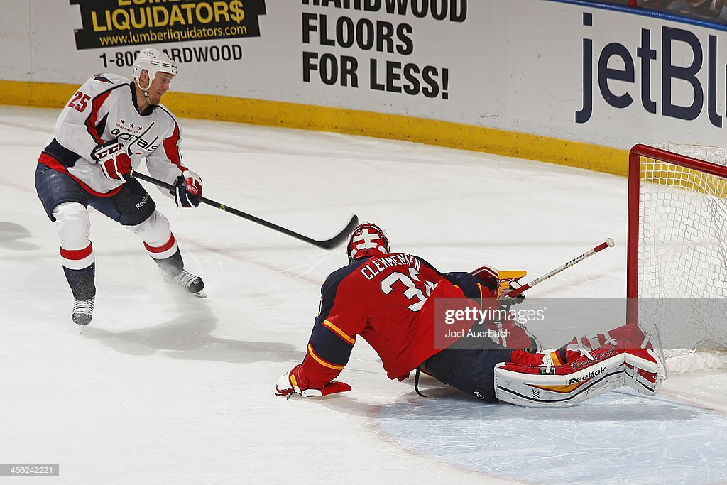 Goaltender <a gi-track='captionPersonalityLinkClicked' href=/galleries/search?phrase=Scott+Clemmensen&family=editorial&specificpeople=214674 ng-click='$event.stopPropagation()'>Scott Clemmensen</a> #30 of the Florida Panthers stops the shootout attempt by <a gi-track='captionPersonalityLinkClicked' href=/galleries/search?phrase=Jason+Chimera&family=editorial&specificpeople=211264 ng-click='$event.stopPropagation()'>Jason Chimera</a> #25 of the Washington Capitals at the BB&T Center on December 13, 2013 in Sunrise, Florida. The Panthers defeated the Capitals 3-2 in a shootout.