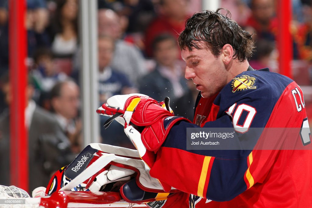 Goaltender Scott Clemmensen of the Florida Panthers takes a moment to relax during a break in action against the Tampa Bay Lightning at the BBT...