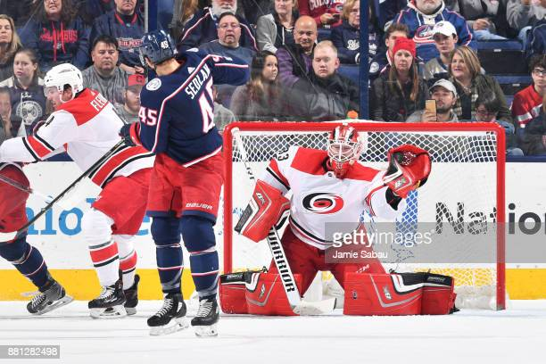 Goaltender Scott Darling of the Carolina Hurricanes makes a glove save during the second period of a game against the Columbus Blue Jackets on...