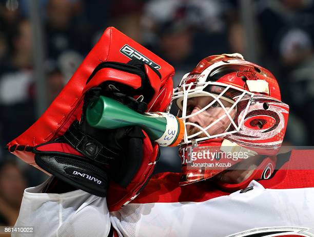 Goaltender Scott Darling of the Carolina Hurricanes stays hydrated during a second period stoppage in play against the Winnipeg Jets at the Bell MTS...