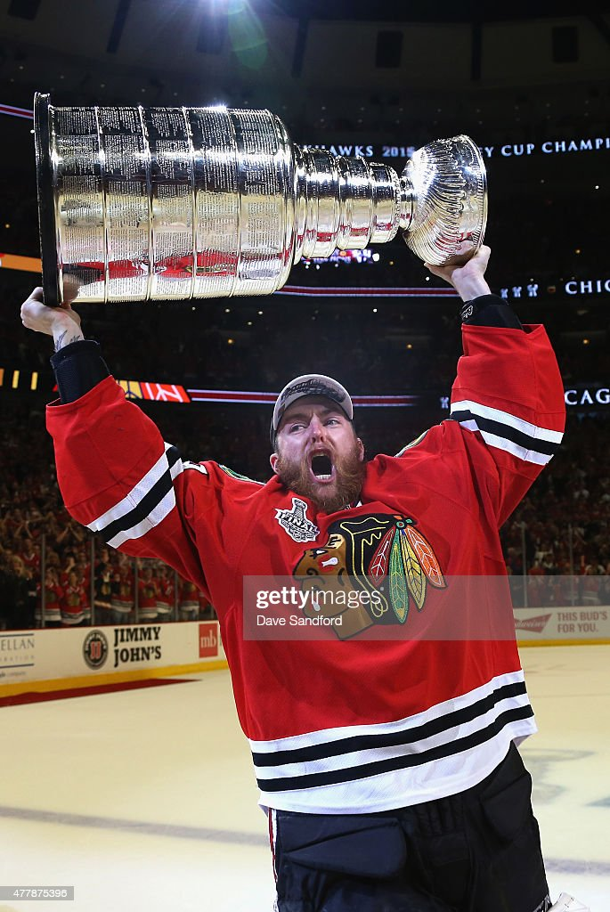 Goaltender Scott Darling of the Chicago Blackhawks hoists the Stanley Cup in celebration after his team defeated the Tampa Bay Lightning 20 in Game...