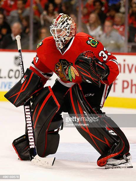 Goaltender Scott Darling of the Chicago Blackhawks plays in the game against the New York Islanders at the United Center on October 10 2015 in...
