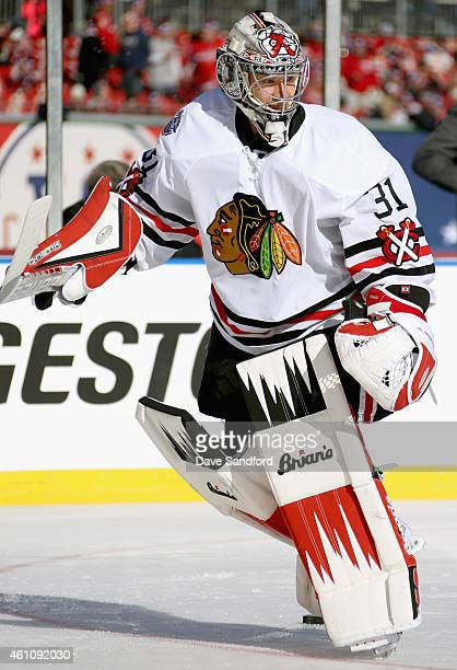 Goaltender Scott Darling of the Chicago Blackhawks warms up before playing against the Washington Capitals in the 2015 Bridgestone NHL Winter Classic...