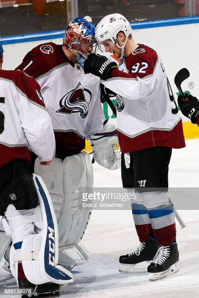 Goaltender Semyon Variamov of the Colorado Avalanche celebrates with teammate Gabriel Landeskog their win over the Florida Panthers at the BBT Center...