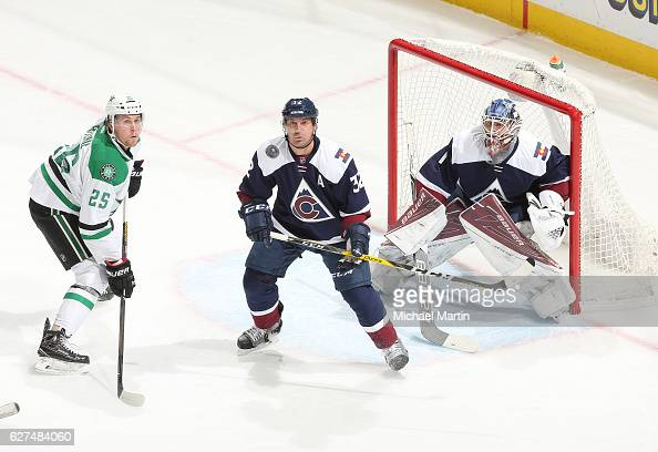 Goaltender Semyon Varlamov and Francois Beauchemin of the Colorado Avalanche watch a puck in the air along side Brett Ritchie of the Dallas Stars at...