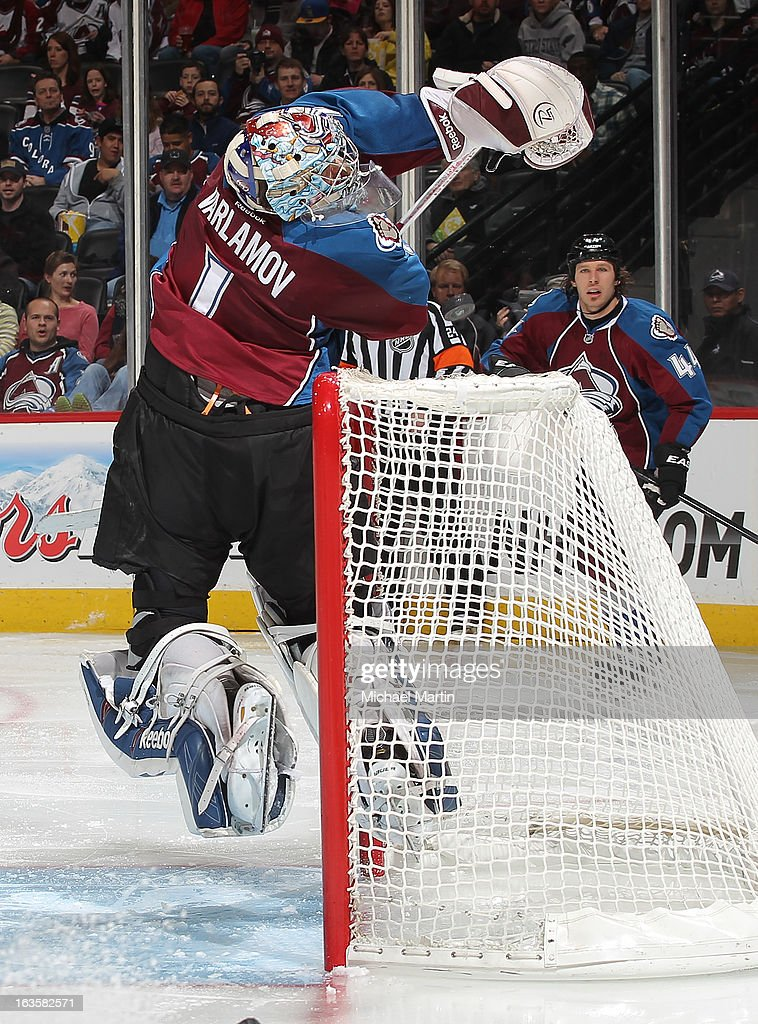 Goaltender <a gi-track='captionPersonalityLinkClicked' href=/galleries/search?phrase=Semyon+Varlamov&family=editorial&specificpeople=6264893 ng-click='$event.stopPropagation()'>Semyon Varlamov</a> #1 of the Colorado Avalanche jumps up to make a save behind the net against the Edmonton Oilers at the Pepsi Center on March 12, 2013 in Denver, Colorado.