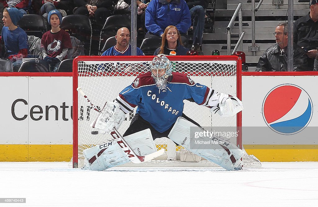 Goaltender <a gi-track='captionPersonalityLinkClicked' href=/galleries/search?phrase=Semyon+Varlamov&family=editorial&specificpeople=6264893 ng-click='$event.stopPropagation()'>Semyon Varlamov</a> #1 of the Colorado Avalanche make a save against the Winnipeg Jets at the Pepsi Center on December 29, 2013 in Denver, Colorado.