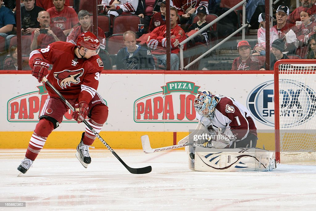 Goaltender <a gi-track='captionPersonalityLinkClicked' href=/galleries/search?phrase=Semyon+Varlamov&family=editorial&specificpeople=6264893 ng-click='$event.stopPropagation()'>Semyon Varlamov</a> #1 of the Colorado Avalanche makes a pad save in front of <a gi-track='captionPersonalityLinkClicked' href=/galleries/search?phrase=Rob+Klinkhammer&family=editorial&specificpeople=2127064 ng-click='$event.stopPropagation()'>Rob Klinkhammer</a> #36 of he Phoenix Coyotes during the second period at Jobing.com Arena on April 6, 2013 in Glendale, Arizona.