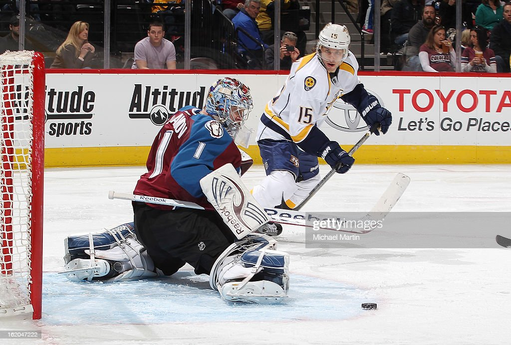 Goaltender <a gi-track='captionPersonalityLinkClicked' href=/galleries/search?phrase=Semyon+Varlamov&family=editorial&specificpeople=6264893 ng-click='$event.stopPropagation()'>Semyon Varlamov</a> #1 of the Colorado Avalanche makes a save against Craig Smith #15 of the Nashville Predators at the Pepsi Center on February 18, 2013 in Denver, Colorado.