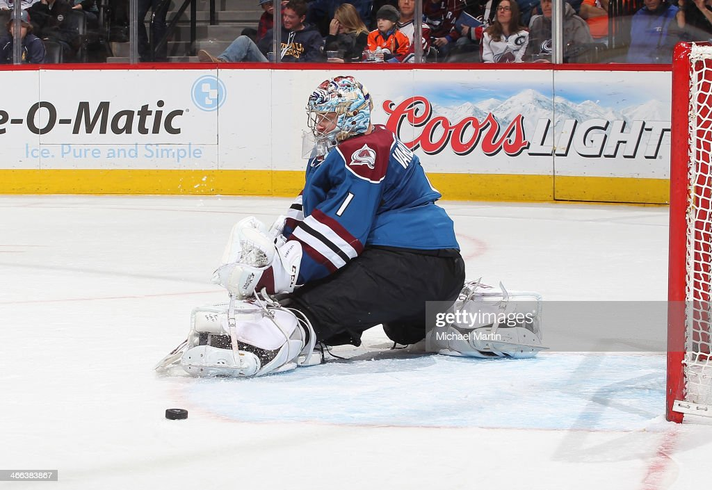 Goaltender <a gi-track='captionPersonalityLinkClicked' href=/galleries/search?phrase=Semyon+Varlamov&family=editorial&specificpeople=6264893 ng-click='$event.stopPropagation()'>Semyon Varlamov</a> #1 of the Colorado Avalanche makes a save against the Buffalo Sabres at the Pepsi Center on February 1, 2014 in Denver, Colorado.