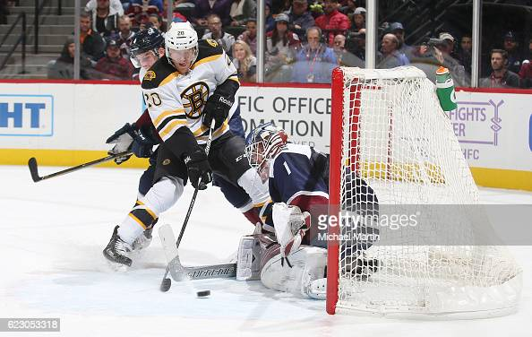 Goaltender Semyon Varlamov of the Colorado Avalanche makes a save against Riley Nash of the Boston Bruins at the Pepsi Center on November 13 2016 in...