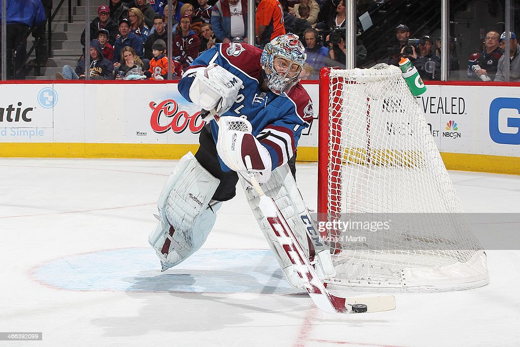 Goaltender <a gi-track='captionPersonalityLinkClicked' href=/galleries/search?phrase=Semyon+Varlamov&family=editorial&specificpeople=6264893 ng-click='$event.stopPropagation()'>Semyon Varlamov</a> #1 of the Colorado Avalanche plays the puck against the Buffalo Sabres at the Pepsi Center on February 1, 2014 in Denver, Colorado.