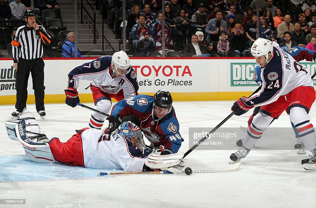 Goaltender Sergei Bobrovsky #72 and Derek MacKenzie #2 of the Columbus Blue Jackets make a save against Mark Olver #40 of the Colorado Avalanche at the Pepsi Center on January 24, 2013 in Denver, Colorado.