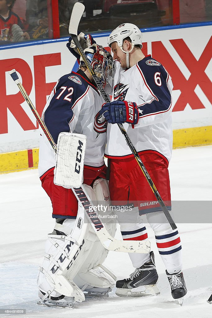 Goaltender <a gi-track='captionPersonalityLinkClicked' href=/galleries/search?phrase=Sergei+Bobrovsky&family=editorial&specificpeople=4488556 ng-click='$event.stopPropagation()'>Sergei Bobrovsky</a> #72 is congratulated by <a gi-track='captionPersonalityLinkClicked' href=/galleries/search?phrase=Nikita+Nikitin&family=editorial&specificpeople=722107 ng-click='$event.stopPropagation()'>Nikita Nikitin</a> #6 of the Columbus Blue Jackets after the win against the Florida Panthers at the BB&T Center on April 12, 2014 in Sunrise, Florida. The Blue Jackets defeated the Panthers 3-2.