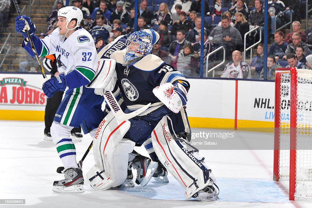 Goaltender <a gi-track='captionPersonalityLinkClicked' href=/galleries/search?phrase=Sergei+Bobrovsky&family=editorial&specificpeople=4488556 ng-click='$event.stopPropagation()'>Sergei Bobrovsky</a> #72 of the Columbus Blue Jackets attempts to push <a gi-track='captionPersonalityLinkClicked' href=/galleries/search?phrase=Dale+Weise&family=editorial&specificpeople=5527418 ng-click='$event.stopPropagation()'>Dale Weise</a> #32 of the Vancouver Canucks during the second period on March 7, 2013 at Nationwide Arena in Columbus, Ohio.
