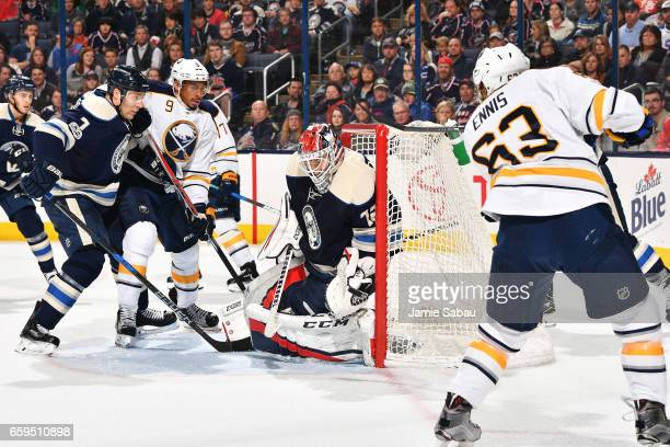 Goaltender Sergei Bobrovsky of the Columbus Blue Jackets blocks a shot by Tyler Ennis of the Buffalo Sabres during the second period of a game on...