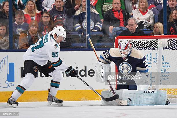 Goaltender Sergei Bobrovsky of the Columbus Blue Jackets blocks a shot taken by Tommy Wingels of the San Jose Sharks during the third period on...