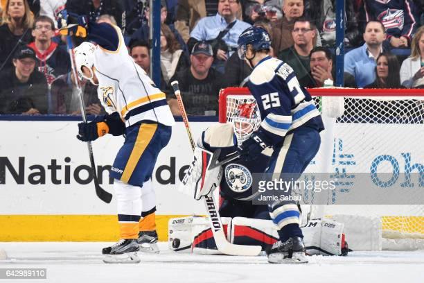 Goaltender Sergei Bobrovsky of the Columbus Blue Jackets blocks a shot taken by Viktor Arvidsson of the Nashville Predators during the third period...