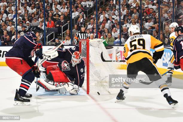 Goaltender Sergei Bobrovsky of the Columbus Blue Jackets blocks a shot taken by Jake Guentzel of the Pittsburgh Penguins during the second period in...