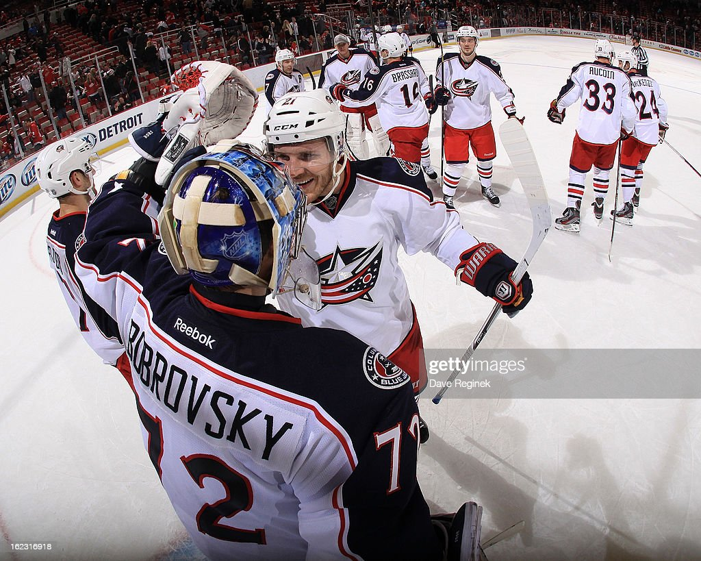 Goaltender <a gi-track='captionPersonalityLinkClicked' href=/galleries/search?phrase=Sergei+Bobrovsky&family=editorial&specificpeople=4488556 ng-click='$event.stopPropagation()'>Sergei Bobrovsky</a> #72 of the Columbus Blue Jackets celebrates a 3-2 win with teammate <a gi-track='captionPersonalityLinkClicked' href=/galleries/search?phrase=James+Wisniewski&family=editorial&specificpeople=688111 ng-click='$event.stopPropagation()'>James Wisniewski</a> #21 against the Detroit Red Wings during a NHL game at Joe Louis Arena on February 21, 2013 in Detroit, Michigan.