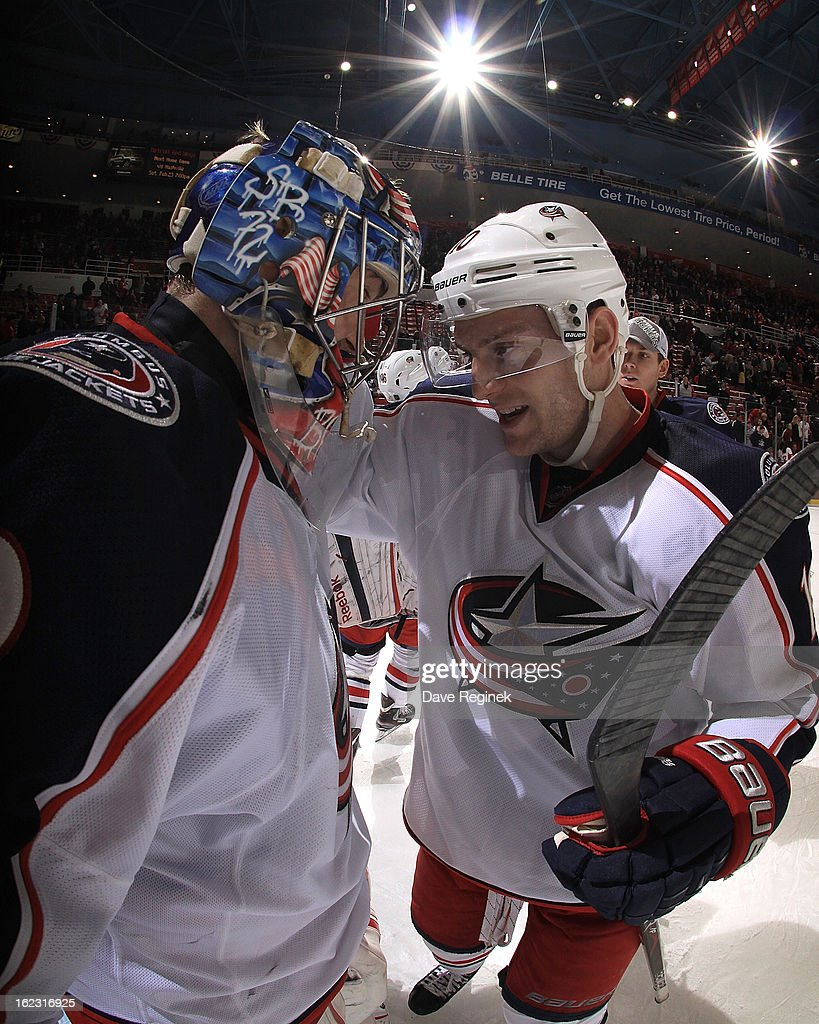 Goaltender <a gi-track='captionPersonalityLinkClicked' href=/galleries/search?phrase=Sergei+Bobrovsky&family=editorial&specificpeople=4488556 ng-click='$event.stopPropagation()'>Sergei Bobrovsky</a> #72 of the Columbus Blue Jackets celebrates a 3-2 win with teammate <a gi-track='captionPersonalityLinkClicked' href=/galleries/search?phrase=Mark+Letestu&family=editorial&specificpeople=4601071 ng-click='$event.stopPropagation()'>Mark Letestu</a> #10 against the Detroit Red Wings during a NHL game at Joe Louis Arena on February 21, 2013 in Detroit, Michigan.
