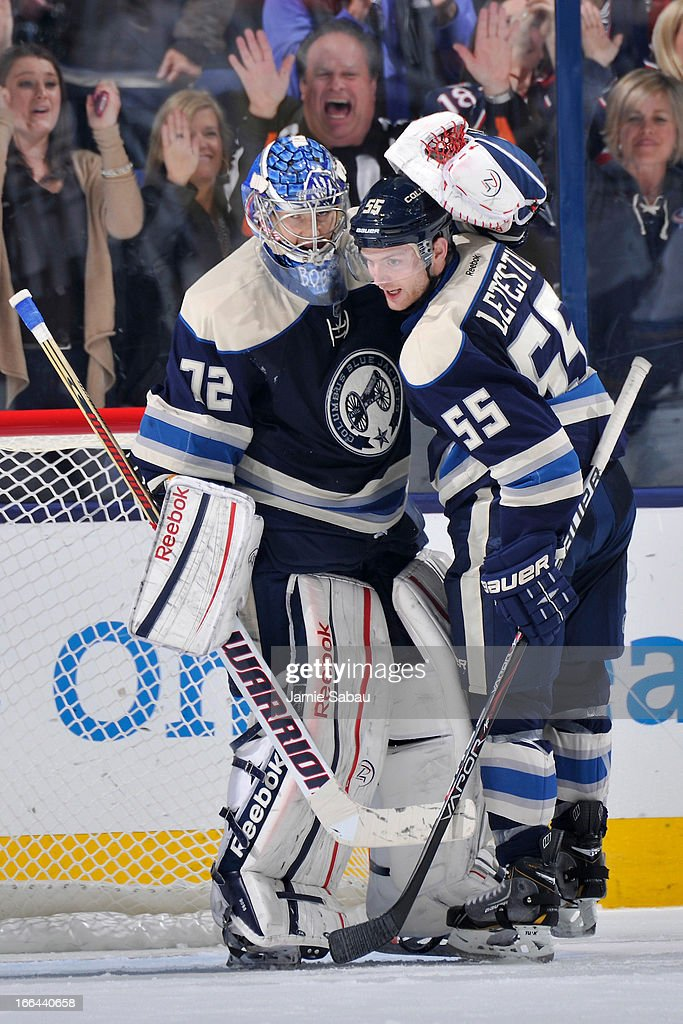 Goaltender <a gi-track='captionPersonalityLinkClicked' href=/galleries/search?phrase=Sergei+Bobrovsky&family=editorial&specificpeople=4488556 ng-click='$event.stopPropagation()'>Sergei Bobrovsky</a> #72 of the Columbus Blue Jackets celebrates a win against the St. Louis Blues with teammate <a gi-track='captionPersonalityLinkClicked' href=/galleries/search?phrase=Mark+Letestu&family=editorial&specificpeople=4601071 ng-click='$event.stopPropagation()'>Mark Letestu</a> #55 on April 12, 2013 at Nationwide Arena in Columbus, Ohio. Columbus defeated St. Louis 4-1.