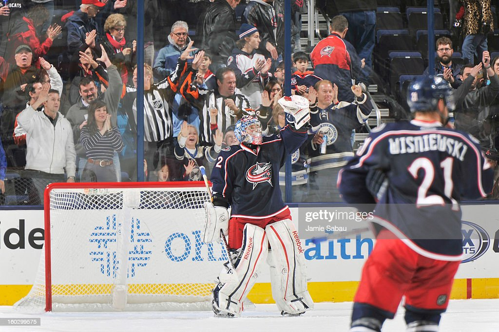 Goaltender <a gi-track='captionPersonalityLinkClicked' href=/galleries/search?phrase=Sergei+Bobrovsky&family=editorial&specificpeople=4488556 ng-click='$event.stopPropagation()'>Sergei Bobrovsky</a> #72 of the Columbus Blue Jackets celebrates after the Columbus Blue Jackets defeated the Dallas Stars 2-1 for their first regulation win on January 28, 2013 at Nationwide Arena in Columbus, Ohio.