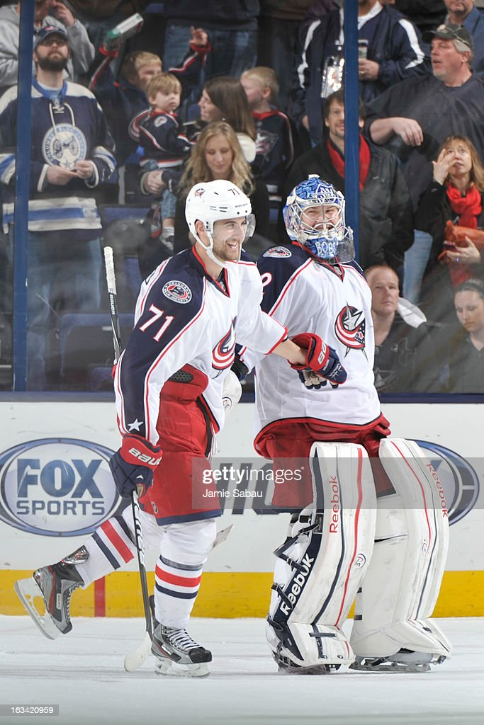 Goaltender <a gi-track='captionPersonalityLinkClicked' href=/galleries/search?phrase=Sergei+Bobrovsky&family=editorial&specificpeople=4488556 ng-click='$event.stopPropagation()'>Sergei Bobrovsky</a> #72 of the Columbus Blue Jackets celebrates his first shutout of the season with teammate <a gi-track='captionPersonalityLinkClicked' href=/galleries/search?phrase=Nick+Foligno&family=editorial&specificpeople=537821 ng-click='$event.stopPropagation()'>Nick Foligno</a> #71 of the Columbus Blue Jackets on March 9, 2013 at Nationwide Arena in Columbus, Ohio. Columbus defeated Detroit 3-0.