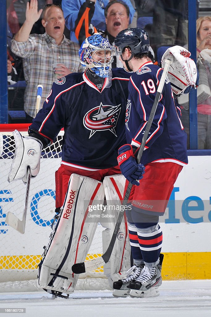 Goaltender <a gi-track='captionPersonalityLinkClicked' href=/galleries/search?phrase=Sergei+Bobrovsky&family=editorial&specificpeople=4488556 ng-click='$event.stopPropagation()'>Sergei Bobrovsky</a> #72 of the Columbus Blue Jackets celebrates his shutout game against the San Jose Sharks with <a gi-track='captionPersonalityLinkClicked' href=/galleries/search?phrase=Ryan+Johansen&family=editorial&specificpeople=6698841 ng-click='$event.stopPropagation()'>Ryan Johansen</a> #19 of the Columbus Blue Jackets on April 9, 2013 at Nationwide Arena in Columbus, Ohio. Columbus defeated San Jose 4-0.