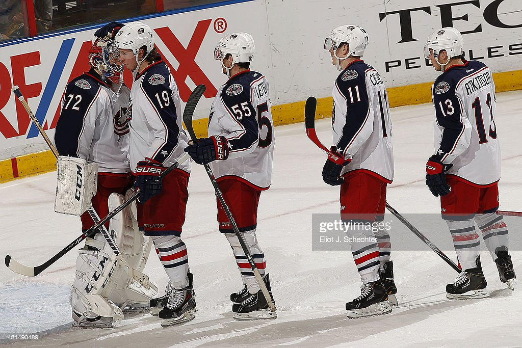 Goaltender <a gi-track='captionPersonalityLinkClicked' href=/galleries/search?phrase=Sergei+Bobrovsky&family=editorial&specificpeople=4488556 ng-click='$event.stopPropagation()'>Sergei Bobrovsky</a> #72 of the Columbus Blue Jackets celebrates their win with teammates against the Florida Panthers at the BB&T Center on April 12, 2014 in Sunrise, Florida.