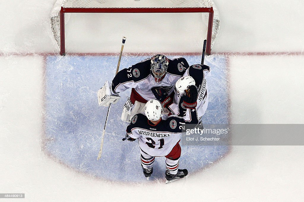 Goaltender <a gi-track='captionPersonalityLinkClicked' href=/galleries/search?phrase=Sergei+Bobrovsky&family=editorial&specificpeople=4488556 ng-click='$event.stopPropagation()'>Sergei Bobrovsky</a> #72 of the Columbus Blue Jackets celebrates their win with teammates Jack Johnson #7 and <a gi-track='captionPersonalityLinkClicked' href=/galleries/search?phrase=James+Wisniewski&family=editorial&specificpeople=688111 ng-click='$event.stopPropagation()'>James Wisniewski</a> #21 against the Florida Panthers at the BB&T Center on April 12, 2014 in Sunrise, Florida.