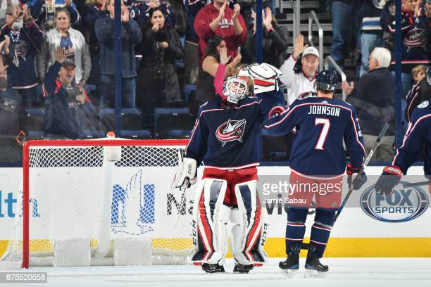 Goaltender Sergei Bobrovsky of the Columbus Blue Jackets celebrates with Jack Johnson of the Columbus Blue Jackets after shutting out the New York...