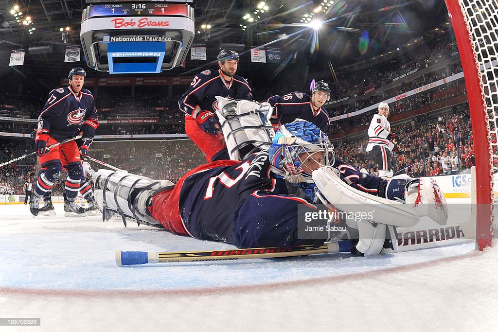 Goaltender Sergei Bobrovsky #72 of the Columbus Blue Jackets covers the puck during the third period on March 14, 2013 at Nationwide Arena in Columbus, Ohio. Chicago defeated Columbus 2-1 in a shootout.