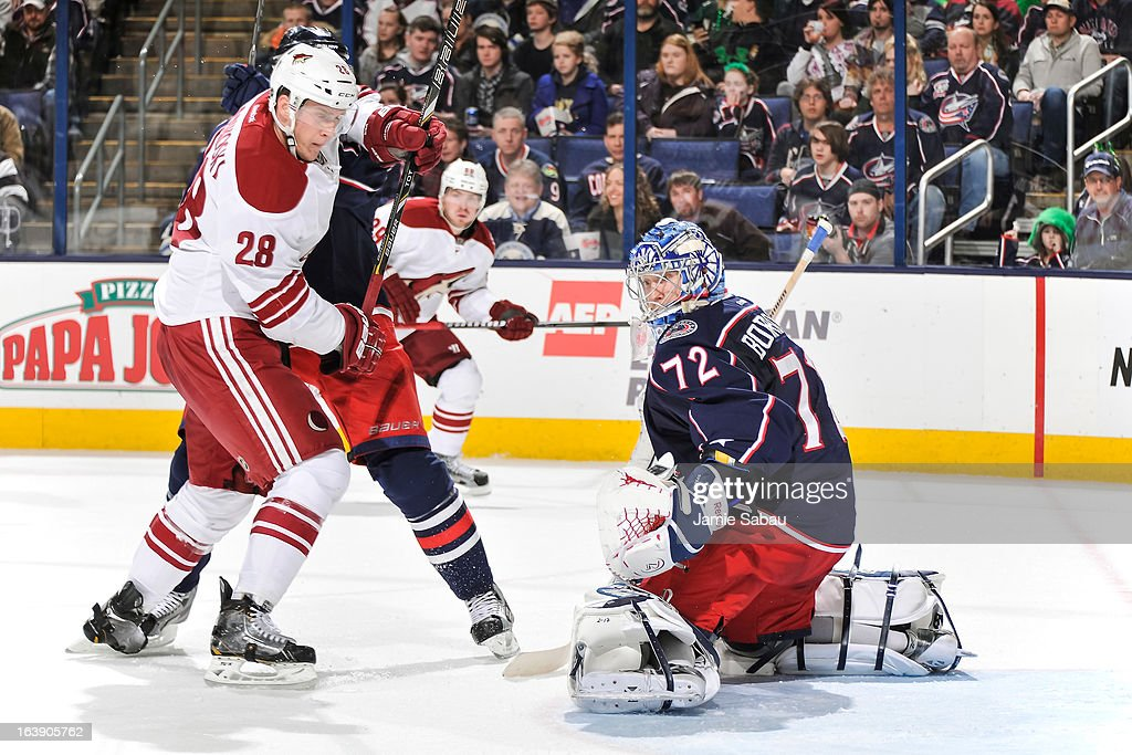 Goaltender Sergei Bobrovsky #72 of the Columbus Blue Jackets defends the net against Lauri Korpikoski #28 of the Phoenix Coyotes on March 16, 2013 at Nationwide Arena in Columbus, Ohio.