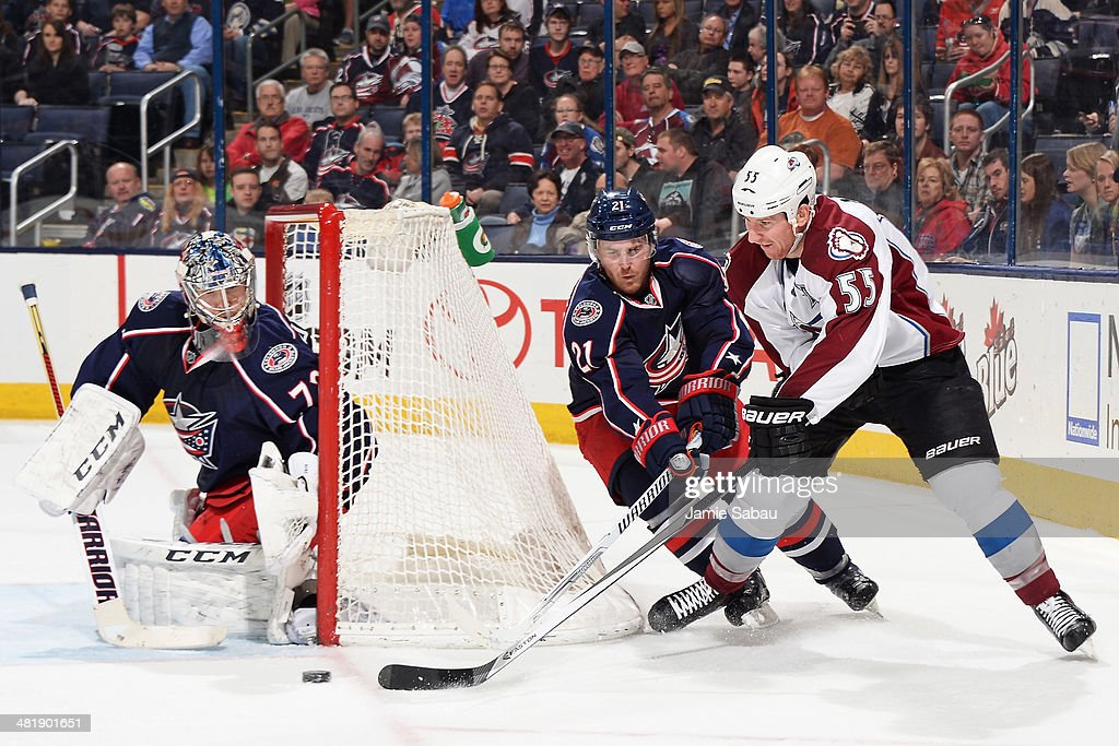 Goaltender Sergei Bobrovsky #72 of the Columbus Blue Jackets defends the net as teammate James Wisniewski #21 and Cody McLeod #55 of the Colorado Avalanche battle for the puck during the second period on April 1, 2014 at Nationwide Arena in Columbus, Ohio.