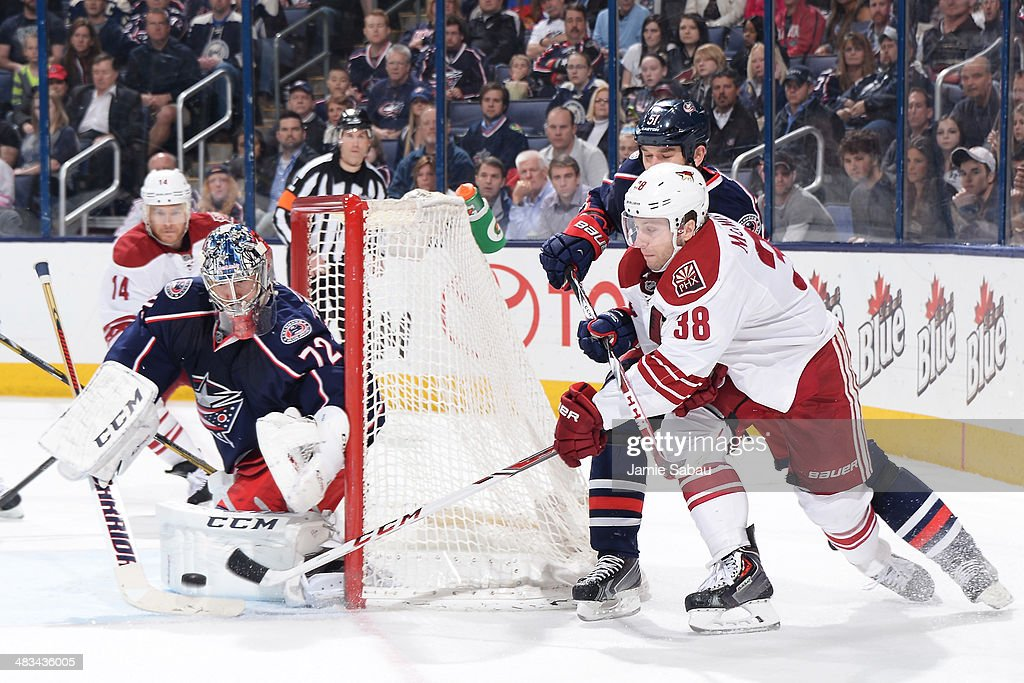 Goaltender <a gi-track='captionPersonalityLinkClicked' href=/galleries/search?phrase=Sergei+Bobrovsky&family=editorial&specificpeople=4488556 ng-click='$event.stopPropagation()'>Sergei Bobrovsky</a> #72 of the Columbus Blue Jackets defends the net as <a gi-track='captionPersonalityLinkClicked' href=/galleries/search?phrase=Brandon+McMillan&family=editorial&specificpeople=4556376 ng-click='$event.stopPropagation()'>Brandon McMillan</a> #38 of the Phoenix Coyotes attempts a wrap-around shot during the second period on April 8, 2014 at Nationwide Arena in Columbus, Ohio.