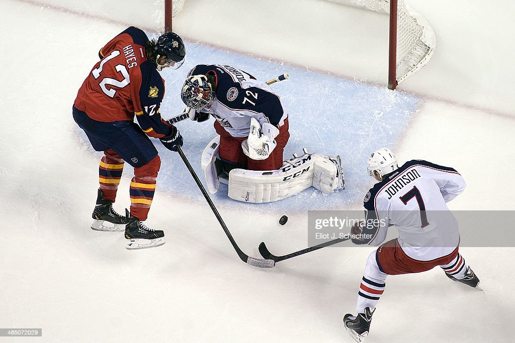 Goaltender Sergei Bobrovsky #72 of the Columbus Blue Jackets defends the net with the help of teammate Jack Johnson #7 against Jimmy Hayes #12 of the Florida Panthers at the BB&T Center on April 12, 2014 in Sunrise, Florida.