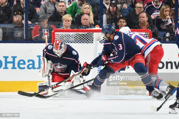 Goaltender Sergei Bobrovsky of the Columbus Blue Jackets defends the net as Seth Jones of the Columbus Blue Jackets battles for position with Brady...