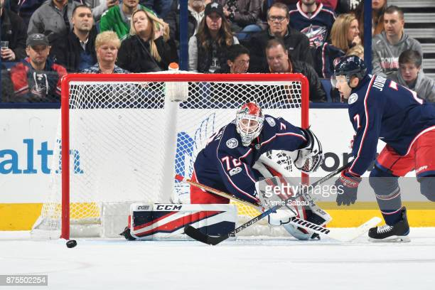 Goaltender Sergei Bobrovsky of the Columbus Blue Jackets defends the net as Jack Johnson of the Columbus Blue Jackets skates after a loose puck...