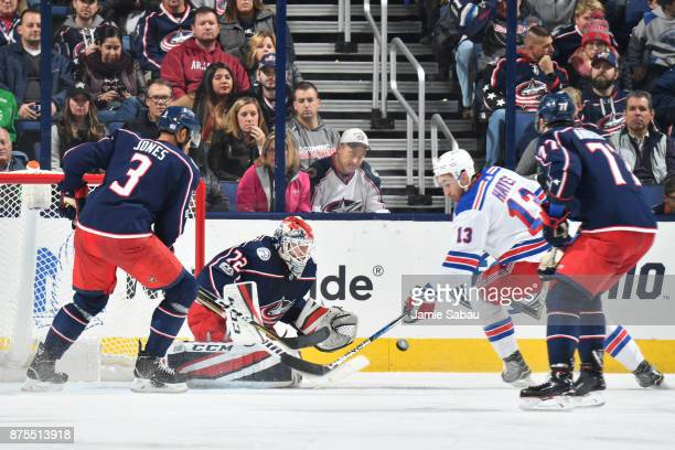 Goaltender Sergei Bobrovsky of the Columbus Blue Jackets defends the net as Seth Jones of the Columbus Blue Jackets and Kevin Hayes of the New York...