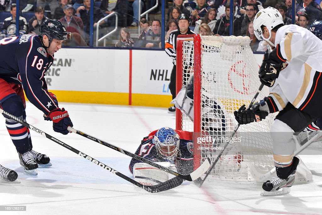 Goaltender <a gi-track='captionPersonalityLinkClicked' href=/galleries/search?phrase=Sergei+Bobrovsky&family=editorial&specificpeople=4488556 ng-click='$event.stopPropagation()'>Sergei Bobrovsky</a> #72 of the Columbus Blue Jackets dives to defend the goal during the second period against the Anaheim Ducks on March 31, 2013 at Nationwide Arena in Columbus, Ohio.