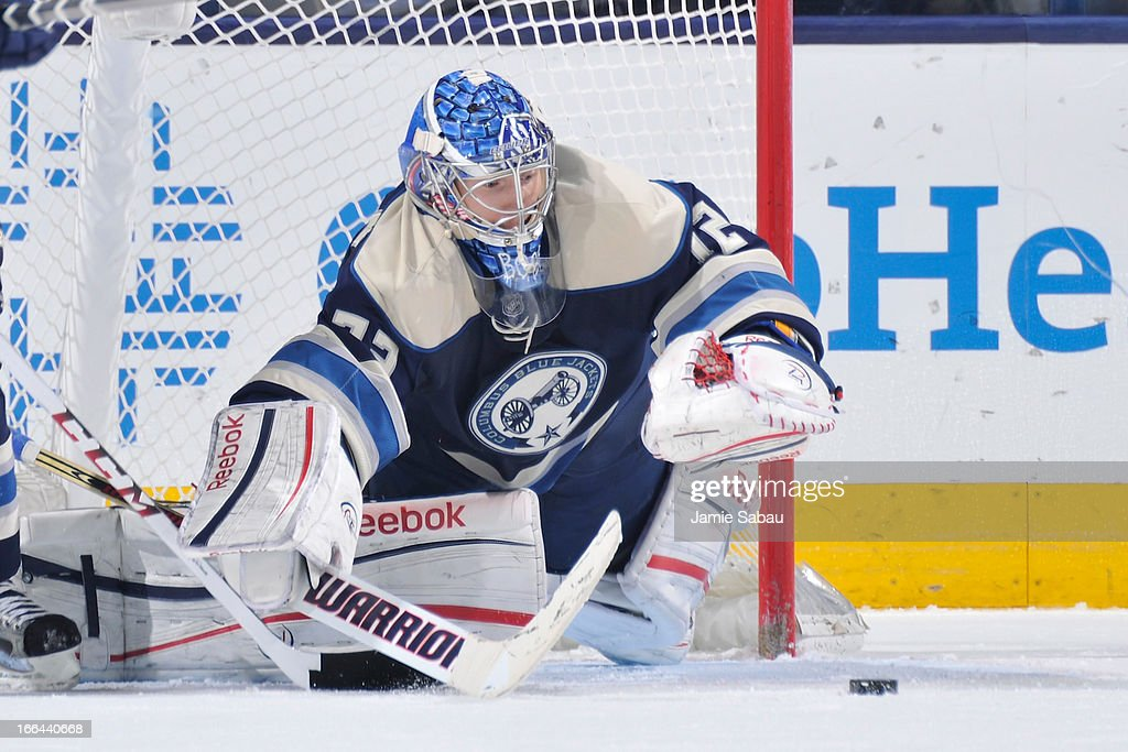 Goaltender <a gi-track='captionPersonalityLinkClicked' href=/galleries/search?phrase=Sergei+Bobrovsky&family=editorial&specificpeople=4488556 ng-click='$event.stopPropagation()'>Sergei Bobrovsky</a> #72 of the Columbus Blue Jackets dives forward to cover the puck during the third period against the St. Louis Blues on April 12, 2013 at Nationwide Arena in Columbus, Ohio. Columbus defeated St. Louis 4-1.