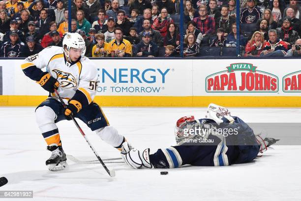 Goaltender Sergei Bobrovsky of the Columbus Blue Jackets fails to knock the puck away from Kevin Fiala of the Nashville Predators during the second...